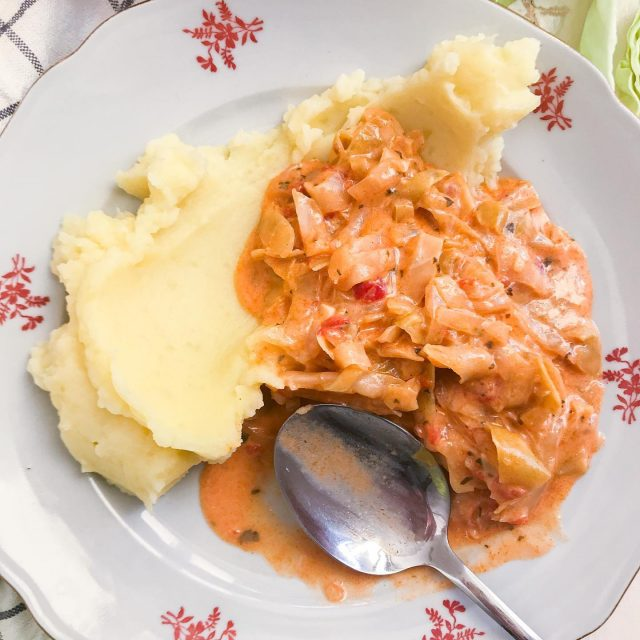 😍 New recipe! 😍 I really want to share more regular, everyday cooking recipes with you and this is one of them. 😁Easy to cook, creamy stewed cabbage that is perfect for the winter. 👍 Similar to the meal my mom cooks.🥰   Recept v 🇸🇮 je že na blogu. (link v bio)  ✨ Creamy stewed cabbage ✨  Ingredients: 1 onion  2 garlic cloves 540 grams of cabbage 250 grams of whole canned tomatoes 100 ml of cooking cream Bay leaf Pinch of ground cumin 1 tea spoon of paprika powder 1 tea spoon of celery (dry leaves spice) Olive oil 1 tea spoon of starch Instructions: Chop up the onion and sear it on olive oil until crystalized. Cut cabbage to smaller ribbons, rinse it under water. Chop up garlic and add it to the onion and sear for a minute, then add in the cabbage. Slice up canned tomatoes and add it to the cabbage. Season with salt, black pepper, celery, paprika powder, cumin and add the bay leaf. (you can also add some sugar to make it a bit sweet) Add 2 dl of water and simmer for up to 40 minutes or until cabbage is soft enough. In the meantime stir and add water little by little when it gets too dry.  Near the end of cooking add cooking cream. Put starch in a cup with some water, stir it and also add to the cabbage and stir until nicely combined. It should thicken it a bit. Taste if needed additional seasoning, serve hot with mash potatoes, polenta or other. Time –  1 hour  Quantity – 4 portions